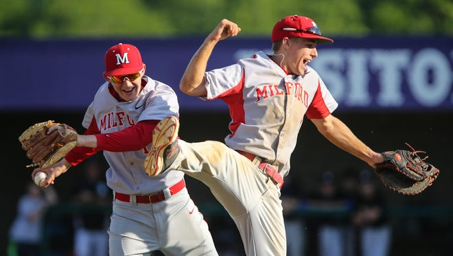 Nate Liles and Brad Hall celebrate Milford's 3-1 win over Springboro in the District final Monday. The Eagles advance to play Bellefontaine on Thursday.