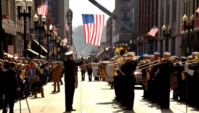 The U.S. Fleet Forces Band from Norfolk, Va., plays for Knoxville area residents who filled the sidewalks on Gay Street for Knoxville's 92nd Veterans Day Parade on Friday, Nov. 10, 2017.