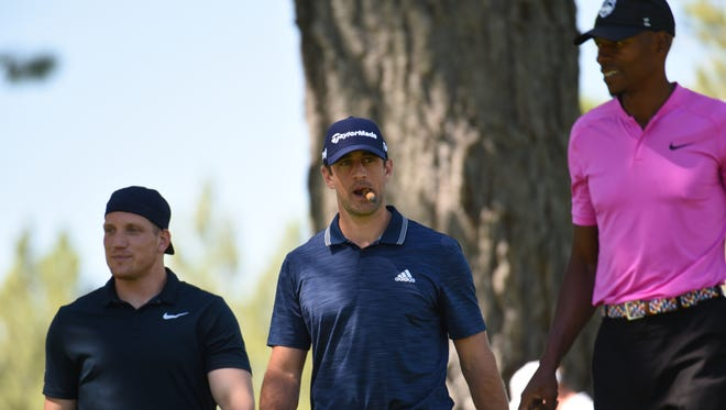 A.J. Hawk, from left, Aaron Rodgers and Ray Allen are shown this week at the American Century Championship celebrity golf tournament in South Lake Tahoe, Nevada.