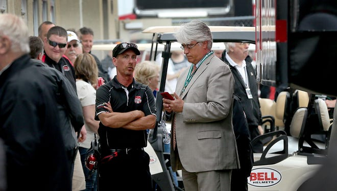 Mark Miles (right) is seen here with IndyCar technical director Kevin Blanch