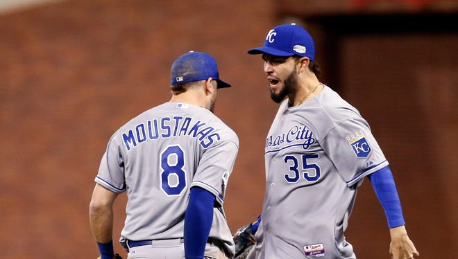 Oct 24, 2014: Kansas City Royals infielders Mike Moustakas (8) and Eric Hosmer (35) celebrate after defeating the San Francisco Giants during game three of the 2014 World Series at AT&T Park.