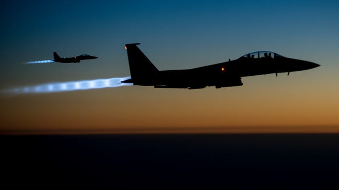 A  pair of U.S. F-15E Strike Eagles flies over northern Iraq after conducting airstrikes in Syria on Sept, 23.