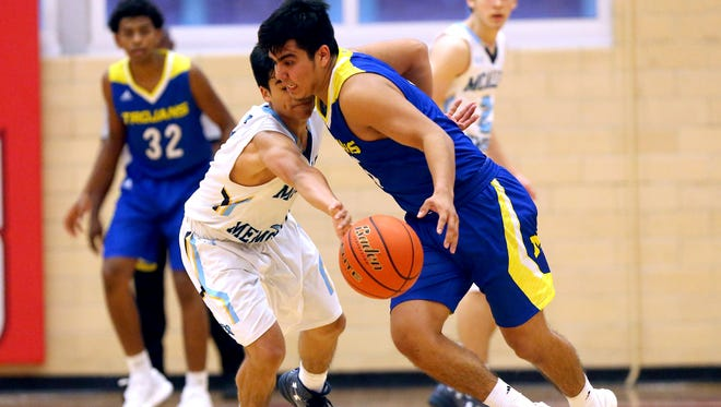 Moody's Jordan Perez dribbles the ball against McAllen Memorial during the Corpus Christi Coaches Association Basketball Tournament on Friday, Dec. 2, 2016, at Ray High School in Corpus Christi.