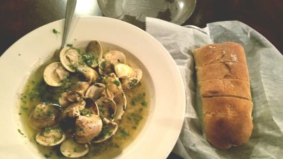 Amato Ristorante's garlic steamed clams were smothered in a garlic olive oil butter sauce and served with a rustic loaf of Italian bread, a must for dipping.