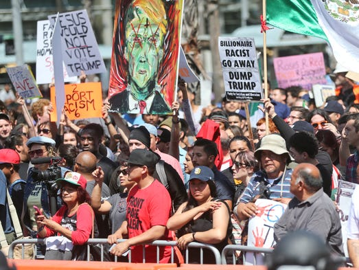 A crowd of anti-Trump demonstrators gathers in front