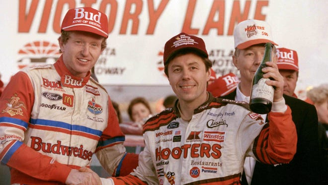Hooters 500 winner Bill Elliott (left) and NASCAR Winston Cup champion Alan Kulwicki share victory lane following the Hooters 500 at Atlanta Motor Speedway in Hampton, Ga., Nov. 15, 1992.