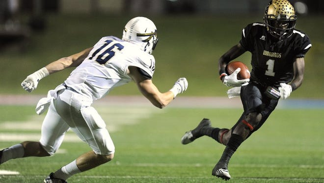 Abilene High wide receiver Raekwon Millsap (1) runs past Keller defensive back Alec Britton (16) during the first quarter of the Eagles' 59-21 win on Oct. 27, 2016, at Shotwell Stadium.