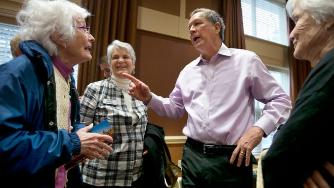 Ohio Gov. John Kasich, a Republican presidential candidate,  speaks with residents at a campaign event Nov. 12 at the RiverWoods Retirement Community in Exeter, N.H.