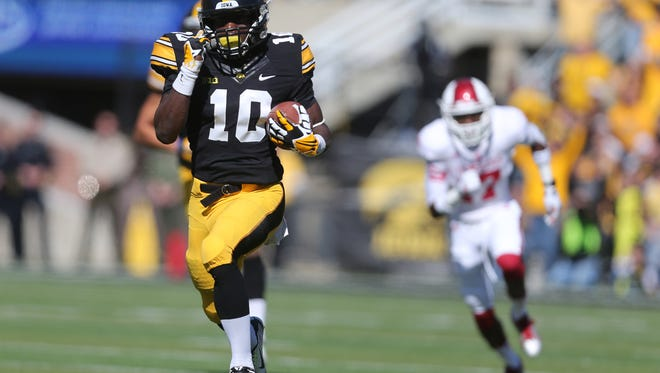 Iowa running back Jonathan Parker runs the ball in for a touchdown against Indiana on Saturday, Oct. 11, 2014, at Kinnick Stadium in Iowa City, Iowa.