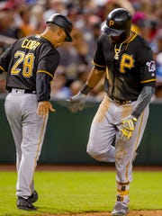 Pirates center fielder Starling Marte high-fives Pirates third base coach Joey Cora after hitting a three-run homer in the fourth inning on June 12, 2018, during the Arizona Diamondbacks' matchup against the Pittsburgh Pirates at Chase Field in Phoenix, Arizona.