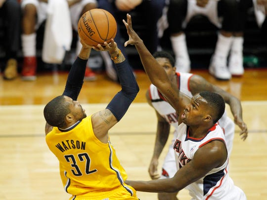 Indiana Pacers guard C.J. Watson (32) is defended by Atlanta Hawks guard Shelvin Mack (8) in the second quarter in game four of the first round of the 2014 NBA Playoffs at Philips Arena.