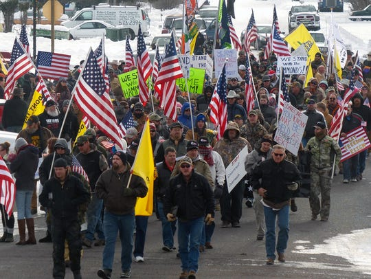 Protesters march on Court Avenue in support of an Oregon