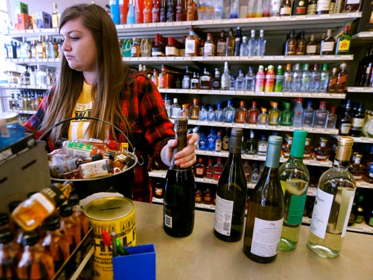 Addison Gilbert checks out wine for a customer  at Murfreesboro Wine & Spirits in Murfreesboro. This store is one of many that will be open this Sunday from 10 am to 10 pm after Governor Bill Haslam signed a bill on Friday, April 20, 2018, allowing wine and liquor sales Sundays.