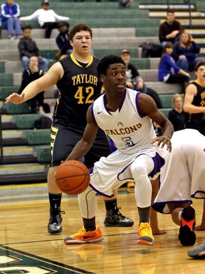 Aiken point guard Eddie Brown-Hogan looks to make a pass from the baseline.