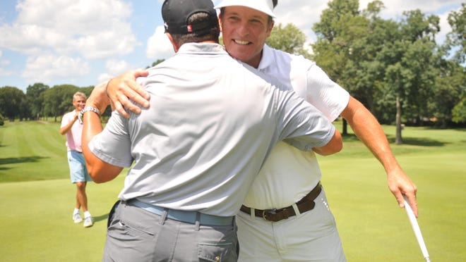 Jamie Lukowicz gets a congratulatory hug from a friend following his championship-winning birdie putt on No. 17 at Pawtucket Country Club, giving the Newport resident his first RIGA State Amateur title.