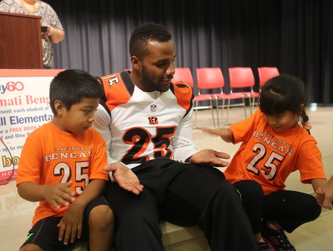 Cincinnati Bengals running back Giovani Bernard hangs out with first-graders Reynaldo Cifuentes and Cecilia Vincente at Heritage Hill Elementary School on Tuesday, September 30, 2014.
