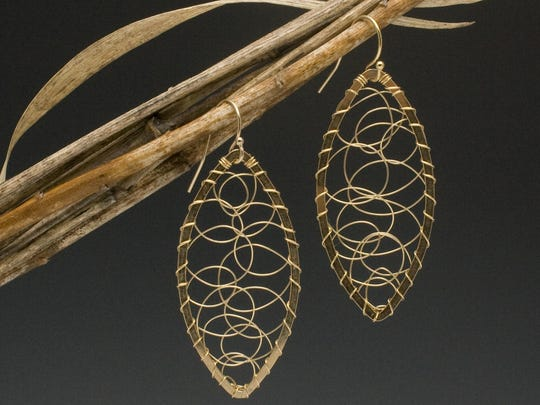 Earrings by Angela Lensch, whose Angela Lensch Gallery is one of the sites in the Aug. 4 Progressive Art Crawl.