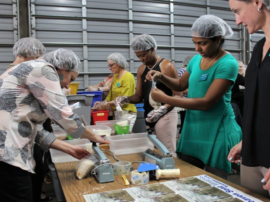 Linda Flores, of Arlington, right, watches teammate Manjusha Shankaradas, of Dallas, second from right, seal a packet of dehydrated foodstuffs mixed with nutritional supplements Monday afternoon. The two women were among 90 Leadership Texas class of 2018 that is meeting in Abilene. The group also toured Dyess Air Force Base and downtown landmarks, such as museums and the Paramount Theatre. Since 2015, about 4 million of the packets have been shipped to Northern Iraq.