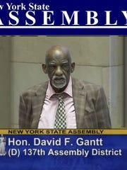 Assemblyman David Gantt via a live video feed of the Assembly debate on a Rochester school modernization bill.