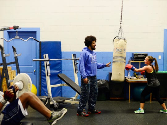 """Andrew Lehigh leads a free fitness class at Voni Grimes Gym. """"I think the biggest thing is helping someone believe in theirself,"""" said Lehigh."""