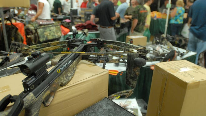 A crossbow sits on a vendor's table during Deerfest at the Winnebago Country Fairgrounds in Oshkosh in 2012.