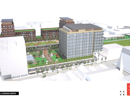 An aerial view, looking north, of the proposed redevelopment of the Burlington Town Center, depicted in a graphic rendering.