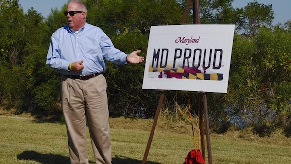 Gov. Larry Hogan unveils a new license plate featuring the Maryland flag on Tuesday, Aug. 30, 2016.