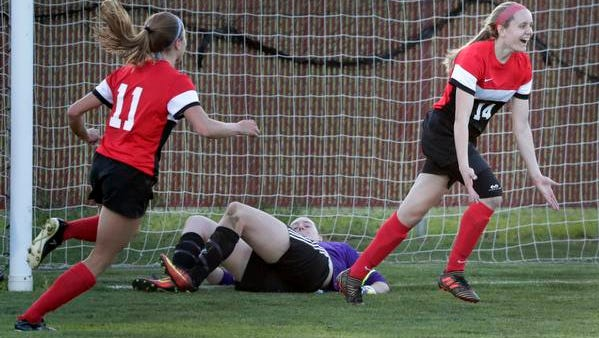 Kimberly High School's Katie Behnke (14) celebrates scoring a goal against Neenah High School's goalkeeper Daydre Basler (1) during their girls soccer game Tuesday, May 22, 2018, in Neenah, Wis. Kimberly won 2-0.
