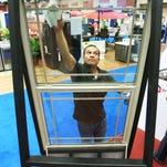 David Cruz of the EP Window Factory prepares a window for display at the Fall Home and Garden Show.