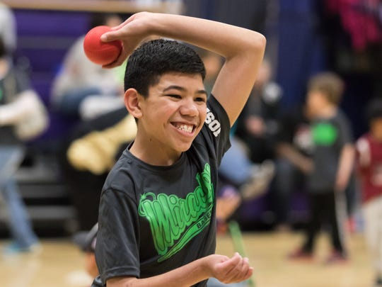 A very joyful Joshua A. throws the ball during the Dream League baseball event on Saturday at Meersheidt Recreation Center.
