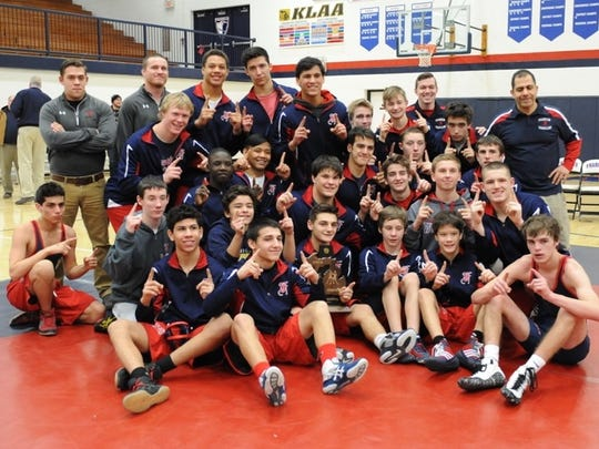 Franklin's wrestling team poses with its most-recent district championship trophy.