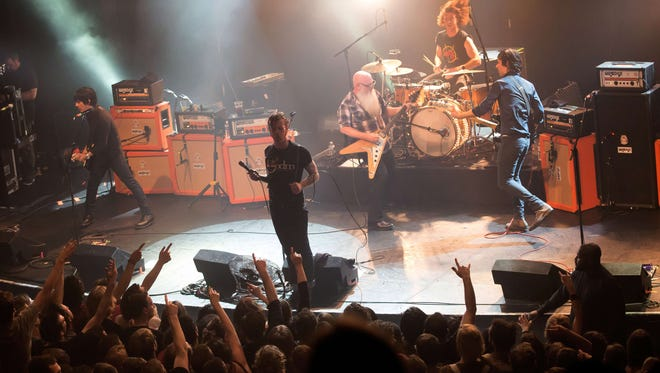 American rock group Eagles of Death Metal perform on stage on November 13, 2015 at the Bataclan concert hall in Paris, a few moments before terrorists stormed into the venue.