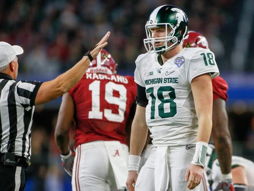 Michigan State QB Connor Cook looks down dejected after