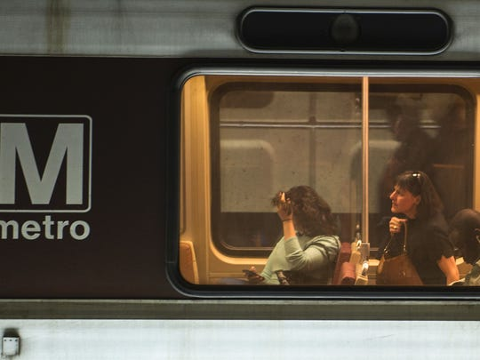 Commuters ride the Metro in Washington, D.C., on April