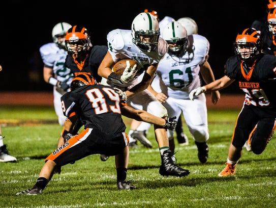 James Buchanan's Colby Bradshaw runs the ball against