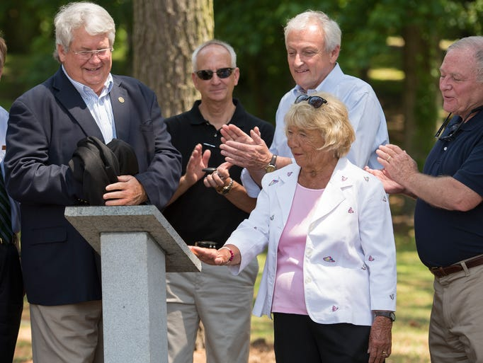 Longtime Bivalve resident Jean Messick, second from right, admires the new plaque unveiled during a dedication at Cedar Hill Marina in Bivalve on Wednesday. The plaque honors contributions of private citizens, the County, and the State's Program Open Space and Waterway Improvement Fund to the founding and growth of the Cedar Hill Marina and Park. Messick's late husband, Cornelius, is named on the plaque. Pictured, from left, are Wicomico County Executive Rick Pollitt, Director of Recreation, Parks, and Tourism Gary Mackes, Sen. Jim Mathias, and Wicomico County Council member John Hall.