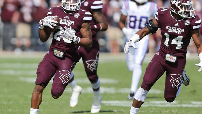 Mississippi State defensive back Brandon Bryant (20) gets help from Mississippi State linebacker Zach Jackson (14) on an interception return for a touchdown in the second half. Mississippi State played Louisiana Tech in a college football game on Saturday, October 17, 2015 at Davis Wade Stadium in Starkville. Photo by Keith Warren (Mandatory Photo Credit)