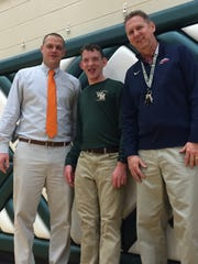 McGregor Long, center, is part of Wilson Memorial's exceptional learners program. He earned a letter as the boys basketball manager this season. Here he stands with basketball coaches Whitney Coffey and Scott Crist.