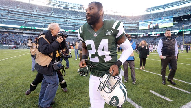 New York Jets corner back Darrelle Revis (24) runs off the field after a game against the Buffalo Bills at MetLife Stadium.