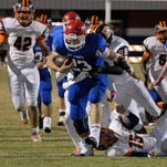 Pace's Quaide Weimerskirch drags an Escambia Gator defender behind him after running over a couple more on this run during action last year at Pace High School.