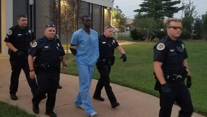 Suspected Nashville church shooter Emanuel Kidega Samson is escorted by police to be transported to jail Sunday, Sept. 24, 2017.