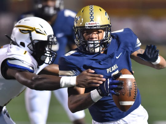 Pearl receiver Johnquarise Patterson (4) runs the ball against Oak Grove during game action Friday, October 27th, 2017 in Pearl, MS.(Bob Smith-For the Clarion Ledger)