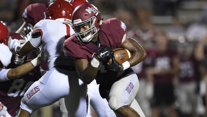 MBA's Ty Chandler runs against Brentwood Academy on Oct. 7, 2016.