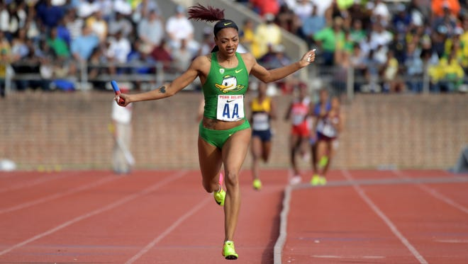 Tarrytown resident and former Mount Vernon and New Rochelle runner Deajah Stevens celebrates after running the anchor leg on the Oregon women's 4 x 400m relay that won the Championship of America race in a meet record 3:24.72 during the 123rd Penn Relays at Franklin Field.