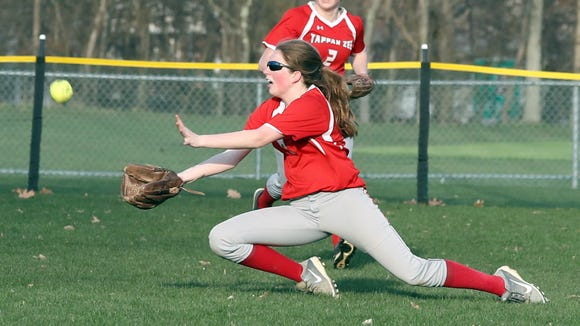 Megan Coyle of Tappan Zee makes a diving catch on a fly ball by Nanuet's Carina Bucci during a girls softball game at Nanuet High School April. 13, 2018. Tappan Zee defeated Nanuet 14-4.