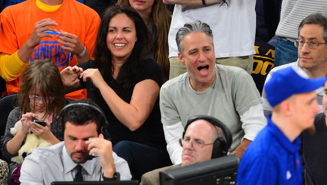 Tracey McShane Stewart and Jon Stewart attend a New York Knicks game at Madison Square Garden in January 2013.