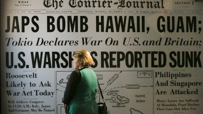Susan Lucas looked at an exhibit of newspaper coverage of the Pearl Harbor attack on display at the Frazier History Museum.  Nov. 29, 2016