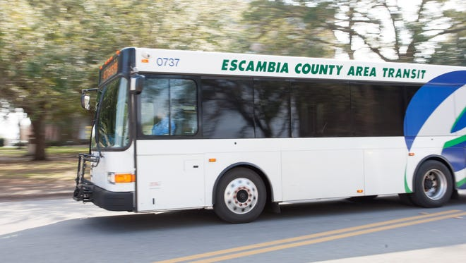 An Escambia County Area Transit (ECAT) bus drives along West Government Street in Pensacola on Friday, February 3, 2017.