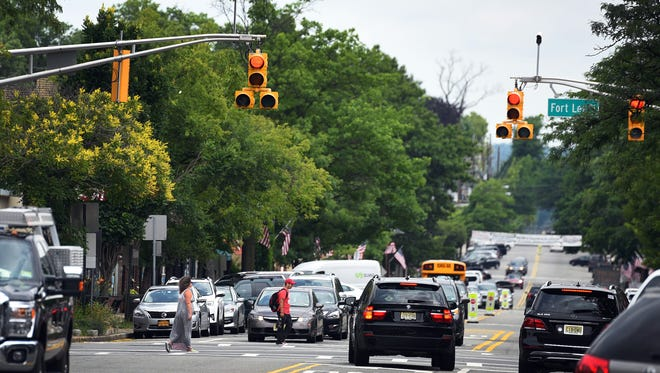 Pedestrians cross July 11, 2017, at the intersection of Fort Lee Road and Broad Avenue in Leonia, N.J., during a 26-second all-red phase for vehicles that has eliminated cars hitting walkers in the past year.