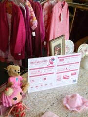 Pink store window display in honor of Breast Cancer